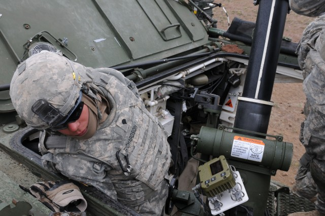 Spc. Andrew Richardson, an indirect fire infantryman, mortar platoon, Headquarters and Headquarters Company, 5th Battalion 20th Infantry Regiment, 3rd Stryker Brigade 2nd Infantry Division, listens for the radio call telling the squad to send mortars down