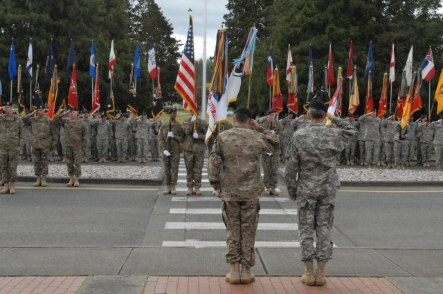 Lt. Gen. Curtis M. Scaparrotti, I Corps commanding general, and Lt. Gen. Howard B. Bromberg, U.S. Forces Command deputy commanding general, salute the colors during the I Corps deployment ceremony May 26 at Joint Base Lewis-McChord.  I Corps will augment
