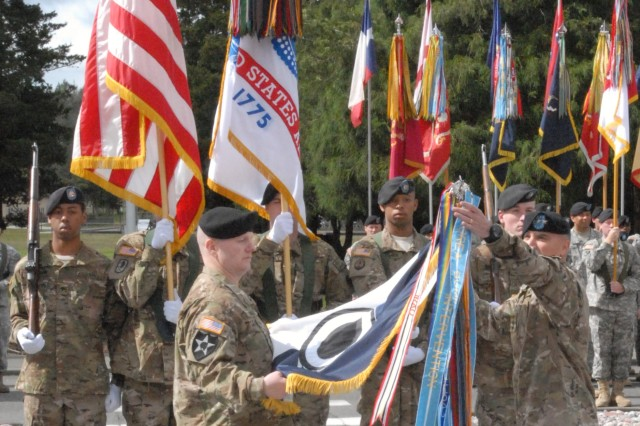 Lt. Gen. Curtis M. Scaparrotti, I Corps commanding general, and Command Sgt. Maj. John W. Troxell, I Corps command sergeant major, case the I Corps colors during the I Corps deployment ceremony May 26 at Joint Base Lewis-McChord.  I Corps will augment Int
