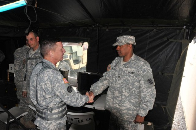 Maj. Gen. Michael J. Terry presents Sgt. 1st Class Michael Williams