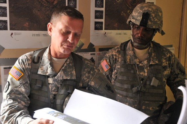 Maj. Gen. Terry and Command Sgt. Maj. Roy Ward look at maps
