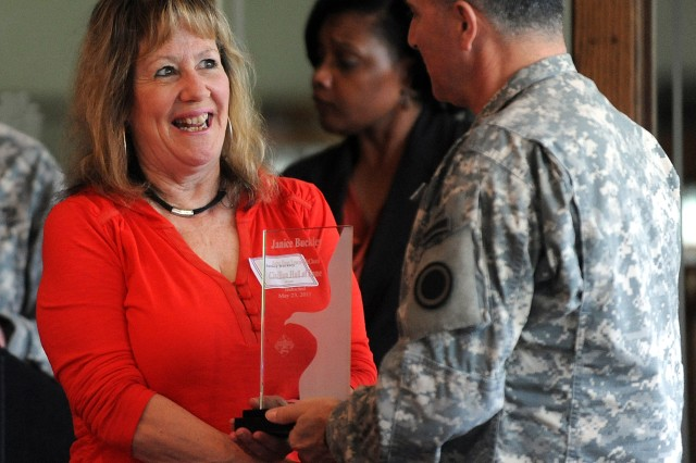 "Janice Buckley is inducted into the JBLM Civilian Hall of Fame during a recent ceremony at the American Lake Club. Buckley, who founded and manages the nonprofit organization ""Heartbeat— Serving Wounded Warriors,"" provides emergency assistance, morale bui"