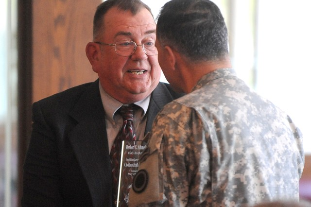Herb Schmeling volunteers full time with many organizations, including the USO, Support America's Armed Forces, Association of the United States Army, the Sergeants Major Association and Fisher House. As a volunteer with the USO, he has personally bade fa