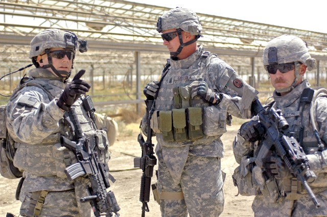 Installation Management Command Command Sgt. Maj. Neil Ciotola (center) talks with then-4th Bde., 2nd Inf. Div. Command Sgt. Maj. John Troxell (left) and 2nd Battalion, 12th Field Artillery Regiment Command Sgt. Maj. Theodore Sutton during a patrol throug