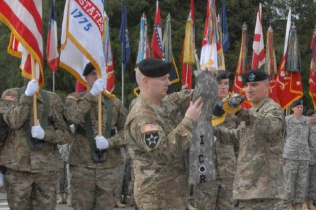 Lt. Gen. Curtis M. Scaparrotti, I Corps commanding general, and Command Sgt. Maj. John W. Troxell, I Corps command sergeant major, case the I Corps colors during the I Corps deployment ceremony May 26 at Joint Base Lewis-McChord.