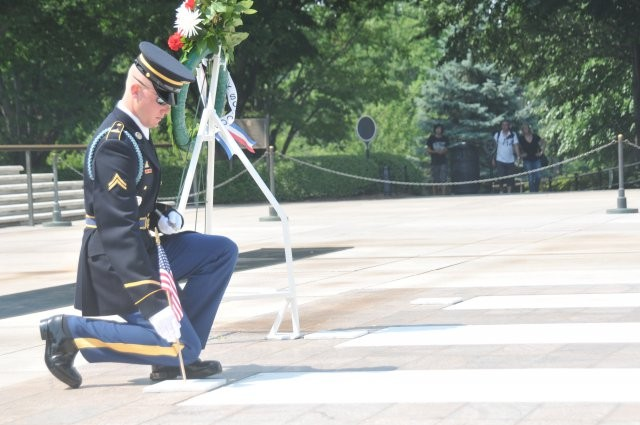 Soldiers put 'flags-in' at nation's cemetery