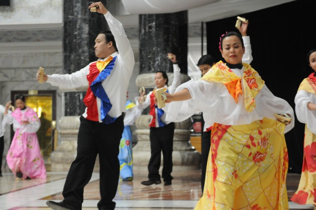 Filipino contractors perform a Spanish and Filipino dance. The steps and music portrayed the charms and celebratory festival within their tradition. (U.S. Army photo by Sgt. Joseph Vine)