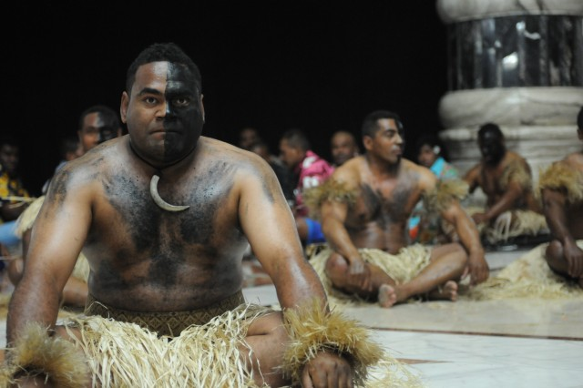 Fijian contractors perform one of their cultural slap dance during the Asian Pacific American Heritage Month capstone event at the Al Faw Palace, May 21.