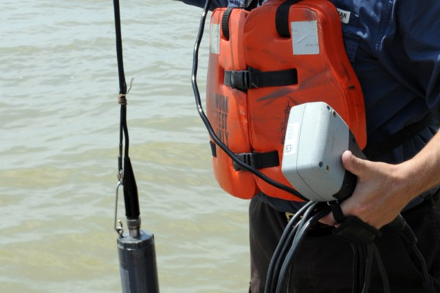 Brian Johnson, environmental engineer with the U.S. Army Corps of Engineers Vicksburg District, prepares to capture water profiles with a water-quality sonde at Eagle Lake, Miss., May 25.