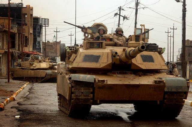 TALL AFAR, Iraq - U.S. Army M1 Abrams tanks maneuver in the streets as they conduct a combat patrol in the city of Tall Afar, Iraq, on Feb. 3, 2005. The tanks and their crews are attached to the 3rd Armored Cavalry Regiment. DoD photo By Staff Sgt. Aaron