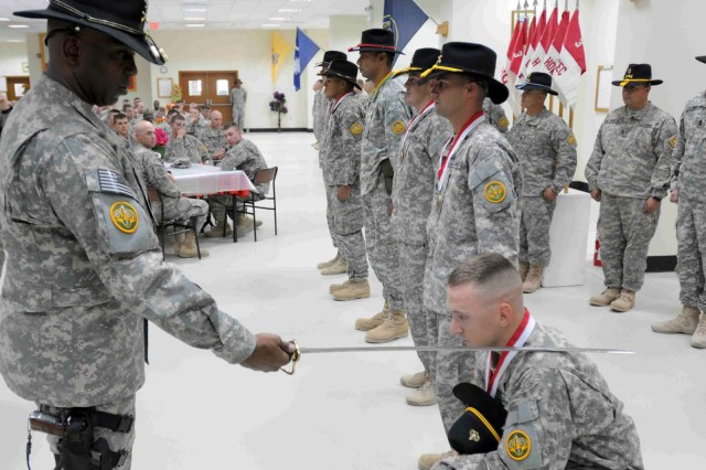 WASIT, Iraq – Col. Reginald E. Allen, commander of the 3rd Armored Cavalry Regiment knights a newly awarded member to the Order of Saint George on Contingency Operating Base Delta May 19, 2011. The order is an armor tradition in which its members number o