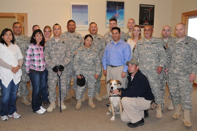"New Mexico-based Soldiers and their guests pose with Rep. Ben Ray Lujan, D-N.M., Chris Chaisson, congressional staffer and his service dog, Doc, after eating lunch together at CBWTU-Utah's muster at the National Ability Center in Park City, Utah. ""There's"