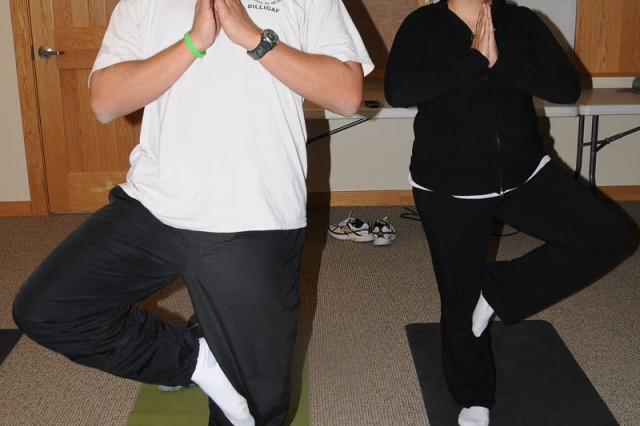 "Sgt. James Hoefert, a Warrior in Transition with the Army Reserve and based in New Mexico, and Sue Hoefert do tree pose during yoga class at the National Ability Center in Park City, Utah. ""Stress affects you physically. Yoga helps us reconnect to our inn"