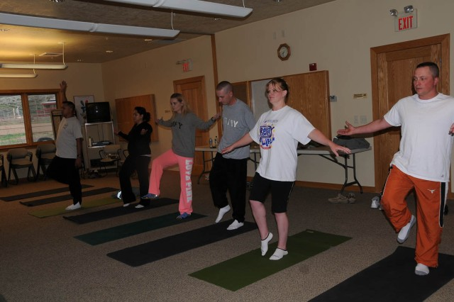 Soldiers from CBWTU-Utah and their guests participate in a yoga class at the National Ability Center in Park City, Utah. CBWTU-Utah brings together its Soldiers from 15 states for musters at the NAC.