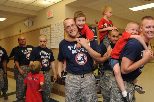 Survivor Outreach Services Soldiers/mentors give Tragedy Assistance Program for Survivors kids a ride at the 2010 TAPS Fort Hood Military Survivor Seminar and Good Grief Camp. About 120 kids, ranging in age from 4 to 19, spent the weekend bonding with bud