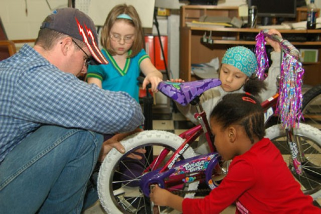 Dan Degrave, Automotive Skills Center worker, teaches his group how to assemble a bicycle during the EDGE! program's Pedal On class at Fort Wainwright, Alaska.