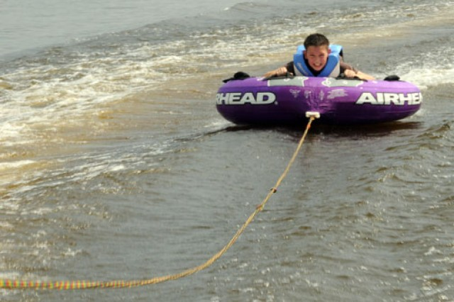 Trevez Sandoval tries out tubing for the first time on Lake Tholocco, Fort Rucker, Ala., as an EDGE! program participant. Other activities included archery and badminton.