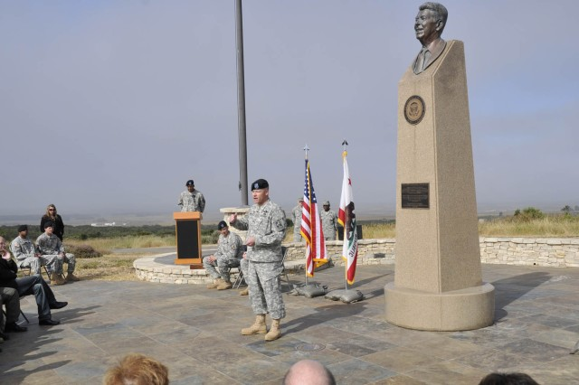 Col. Gregory Bowen speaks to the crowd in front of the Ronald Reagan Missile Defense site at Vandenberg Air Force Base during the 100th Missile Defense Brigade (Ground-based Midcourse Defense) activation and change of command ceremony for Detachment One,