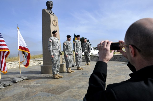 Special guest, Pastor Rob Litzinger takes a picture with his cell phone of the activation and change of command ceremony for Detachment One, 100th Missile Defense Brigade in front of the Ronald Reagan Missile Defense site May 13, 2011 at Vandenberg Air Fo