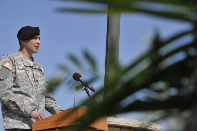 Outgoing commander, Capt. Orlando Cobos, speaks to the crowd at the Ronald Reagan Missile Defense site at Vandenberg Air Force Base during the 100th Missile Defense Brigade (Ground-based Midcourse Defense) activation and change of command ceremony for Det
