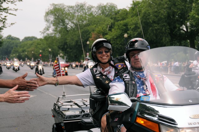 Many of the 400,000 motorcyclists came close to the throngs of people lining Constitution Avenue in Washington, D.C., so they could reach out and thank the supporters.
