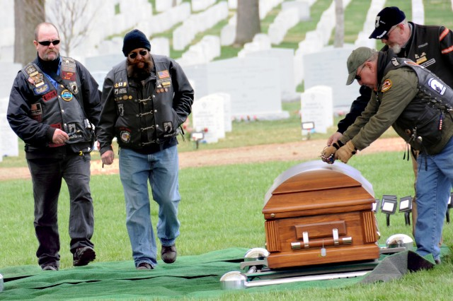 (From left) Bill Mead, Mike Ellis, Don Armstrong and Jim Furr, with Rolling Thunder Virginia Chapter 3, the Art Foss Memorial Chapter, lay colored beads on the caskets of returned World War II Soldiers at Arlington National Cemetery, Va.
