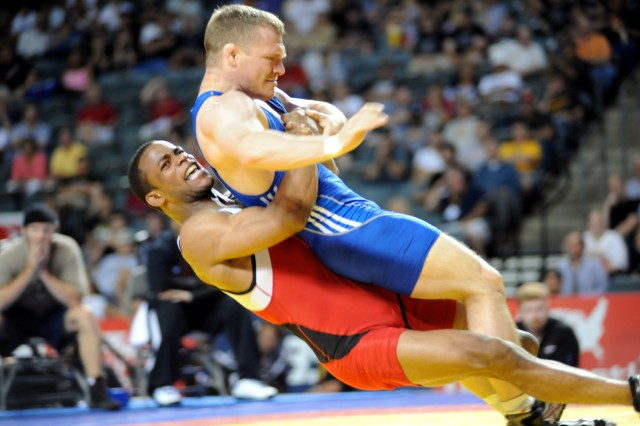 Army World Class Athlete Program Greco-Roman wrestler Spc. Jeremiah Davis (bottom in red) throws Spc. Nathan Piasecki en route to victory in the finals of the 60-kilogram/132-pound division of the 2010 U.S. World Team Trials for Wrestling at the Mid-Ameri