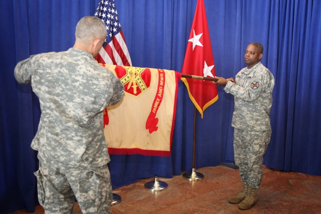 The commanding general of the Family and Morale, Welfare and Recreation Command, Maj. Gen. Reuben Jones, right, and Command Sgt. Maj. Abe Vega, left, prepare the FMWRC colors during the casing ceremony on May 26, 2011.