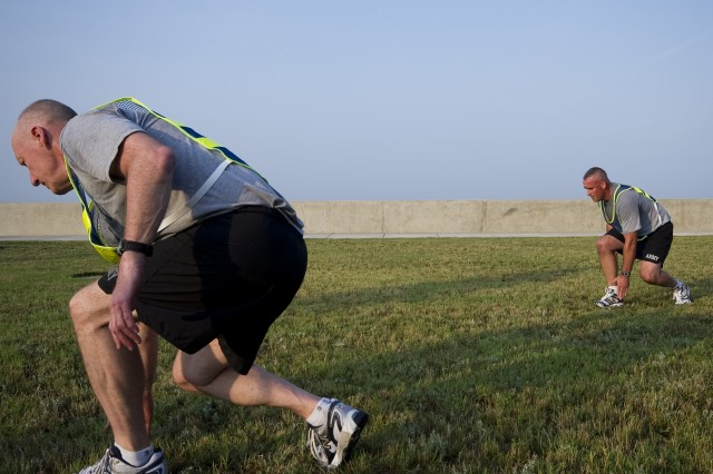 Staff Sgt. Timothy Sarvis, 2010 Active Duty Drill Sergeant of the Year, leads Gen. Robert W. Cone, commanding general of U.S. Army Training and Doctrine Command, in the physical fitness routines found in TC 3-22.20 on  May 31, 2011 on Fort Monroe, Va. (U.
