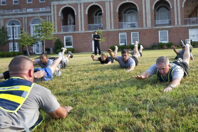 Staff Sgt. Timothy Sarvis, 2010 Active Duty Drill Sergeant of the Year, and Maj. Gen. Richard C. Longo, deputy commanding general for Initial Military Training, perform the Swimmer exercise, a part of Conditioning Drill 2, found in TC 3-22.20 today at Con