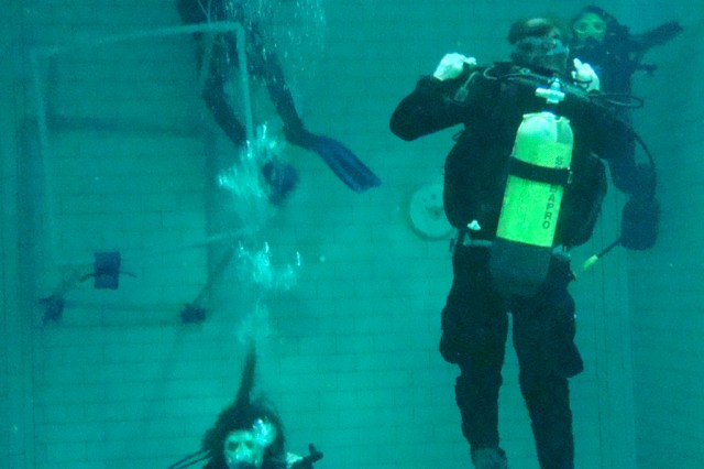 Soldiers from U.S. Army Europe's Headquarters and Headquarters Company, 18th Combat Sustainment Support Battalion, 16th Sustainment Brigade, practice ascent and descent techniques in a facility set up in a former sauerkraut factory, during a scuba diving