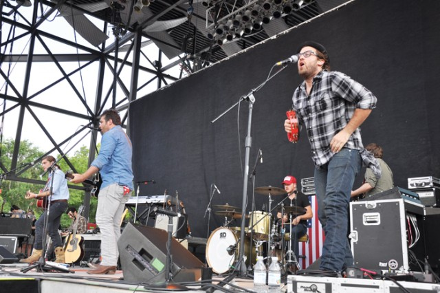 """From left to right, Brett Taylor, Charlie Berry and Matthew Roley of Mockingbird Sun rally the crowd. The Tennessee band's songs include """"That Girl Tonight"""" and """"Redemption Road."""""""