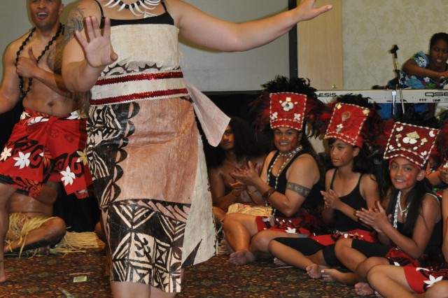 A member of the Fort Irwin Samoan dance group, Samoa Mo Samoa, perform during Fort Irwin and the National Training Center's Asian Pacific American Heritage month celebration on May 31, 2011 at Fort Irwin, Calif.