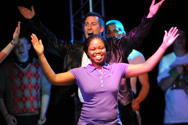 """Spc. Joeneyce Cunningham of Fort Riley, Kan., sings the Journey classic """"Don't Stop Believing"""" during rehearsal for the 2010 U.S. Army Soldier Show at Wallace Theater on Fort Belvoir, Va."""