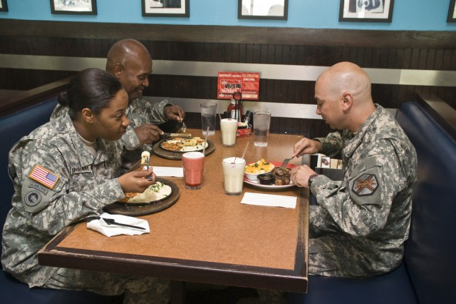 Soldiers enjoy food, drinks and conversation at the Warrior Zone.