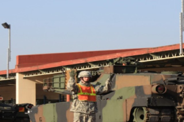 The 662nd Movement Control Team Soldiers load up Army Pre-positioned Stock 4 M1 Abrams in support of 2nd Infantry Division via rail at Camp Carroll.