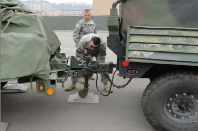 The 662nd Movement Control Team Soldiers weigh in a truck to check for weight balance before moving out.