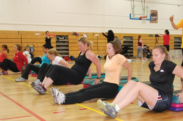 Participants in the Boot Camp fitness class May 24 complete bench dips while their instructor, Courtney Rife (far right), keeps time. The class was one of three events in U.S. Army Garrison Stuttgart chosen to represent the Family and Morale, Welfare and