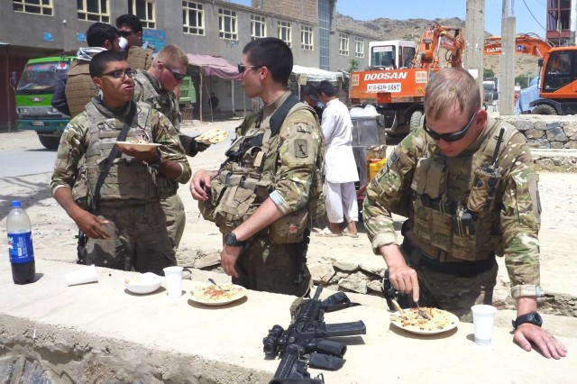 Sgt. Bob Brewer (right) takes a lunch break near Kabul, Afghanistan, with team members.