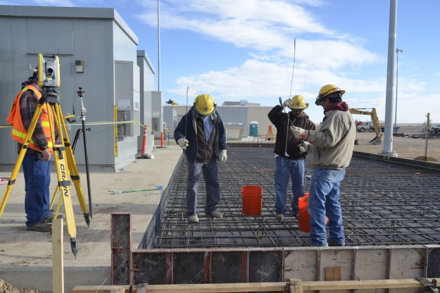 Laborers and a survey crew made final preparations for the concrete placement that took place at the switchgear pad for the Enhanced Reconfiguration Building.