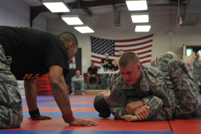 Spc. Darren R. Brons, junior enlisted winner of First Army's 2011 Best Warrior Competition, forces his opponent into submission for the win during a combatives tournament. Soldiers were evaluated on their mastery of specific techniques from the Modern Arm