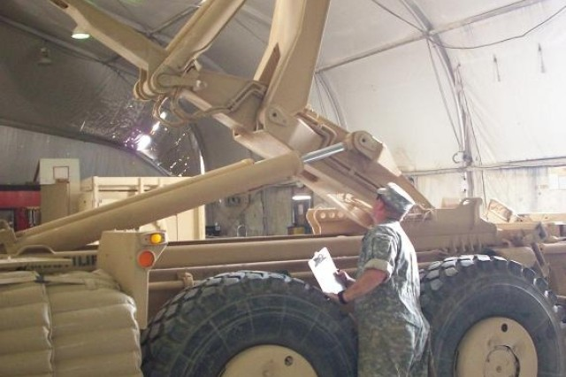 Contingency Operating Base Adder, Iraq – Staff Sgt. Jamie Schaar from Bravo Field Maintenance Company, 215th BSB, 3rd BCT, 1st Cav. Div., performs Quality Assurance/Quality Checks on a Palletized Load System May 22, 2011.