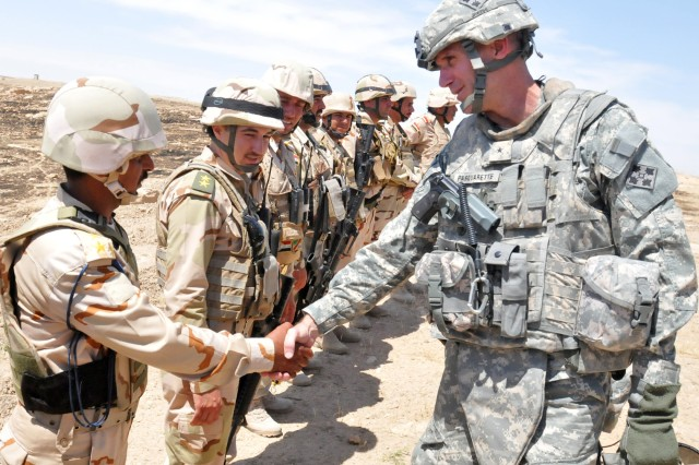 CONTINGENCY OPERATING SITE MAREZ, Iraq - USD-N DCG-S, Brig. Gen. James Pasquarette, shakes hands with Iraqi soldiers from 2nd Batt., 9th Bde., 3rd Iraqi Army Div. after the soldiers completed their month-long training rotation, May 26, 2011.