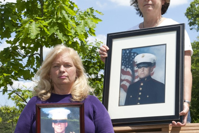 Shawn Wroblewski, left, holds a photo of her son, 2nd Lt. John Wroblewski, who was killed in action April 6, 2004. Charlene Cosgrove-Bowie also holds a photo of her son, Lance Cpl. Christopher Cosgrove III who was killed Oct. 1, 2006.