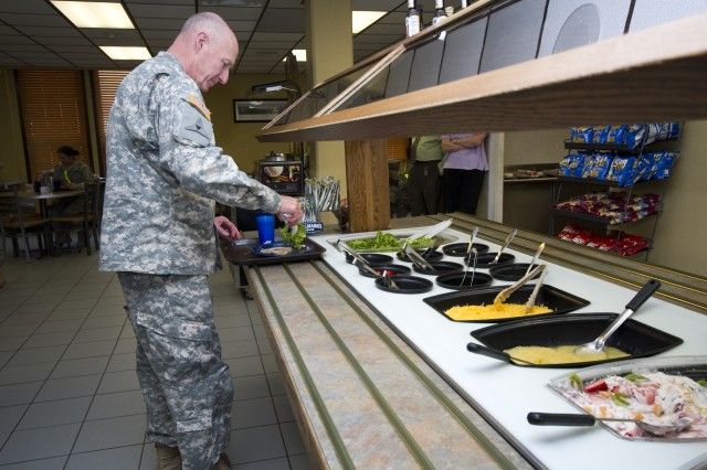 Gen. Robert W. Cone, commanding general of U.S. Army Training and Doctrine Command, serves himself salad greens during his lunch visit with Initial Military Training on Fort Eustis, Va., on May 31, 2011. (U.S. Army photo by Sgt. Angelica Golindano)(RELEAS