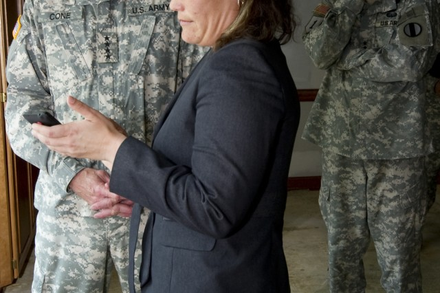 Mollie Sabo from Initial Military Training demonstrates some of the apps designed through the Connecting Soldiers to Digital Applications program to Gen. Robert W. Cone, commanding general of U.S. Army Training and Doctrine Command, during Cone's visit wi