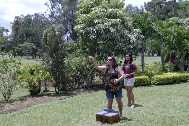 SCHOFIELD BARRACKS, Hawaii - Patty Ishiki (left), throws a horseshoe while her teammate, EunHae Jones (right), both recreation assistants, Tripler Army Medical Center Physical Fitness Center, DFMWR, watches. USAG-HI staff could particpate in activities li