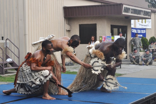 Soldiers from 6-52 Air Defense Artillery Battalion dressed up as Fiji dancers perform a traditional warrior dance in front of the Suwon Community Activity Center, during the annual Asian Pacific Heritage Celebration May 27.