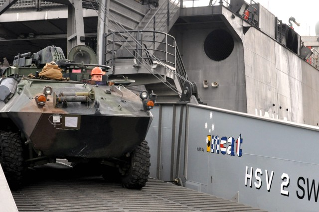 A Marine offloads a light armor vehicle from the HSV 2 Swift naval vessel at the Port of Tan Tan, Morocco, May 11, 2011. The equipment is being assembled in support of Joint Exercise African Lion 11.