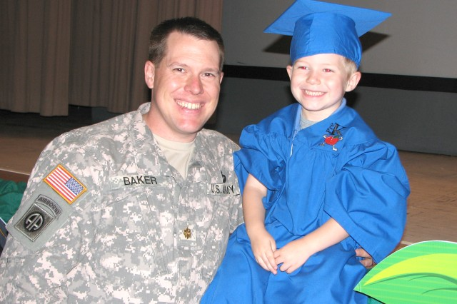 The day was proud for both children and their parents. Maj. Chris Baker, G-4 operations officer, Third Army/U.S. Army Central (Third Army), poses with his son Nathan, 5 following the graduation.